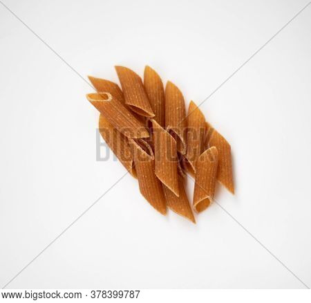 Raw Wholemeal Pasta On A White Background