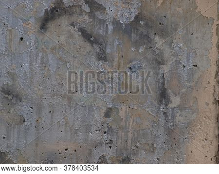 Paint Peal On A Cement Wall At The Top Of A Lakes Dam. The Wall Faces The Lake And Keeps Runners And