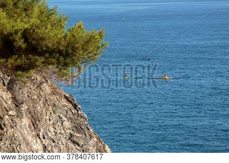 Five Lands, Italy - Two Canoeing Tourists Off The Coast Of Moneglia. High Quality Photo