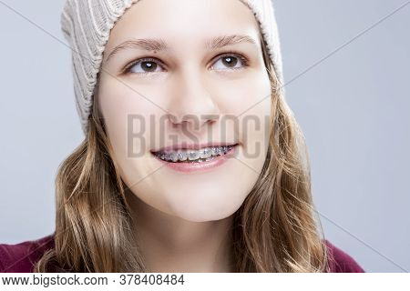 Teenage Ideas. Closeup Portrait Of Happy Laughing Caucasian Teenager Girl With Teeth Brackets Agains