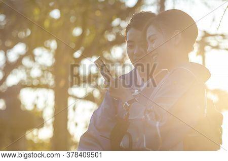 Kyoto, Japan - November, 8, 2019: Japanese Ladies Posing In Geisha Kimono And Taking Pictures At One