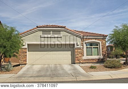 New Ranch, Green, With Brick, Stucco Home In Tucson, Arizona, Usa With Beautiful Blue Sky And Landsc