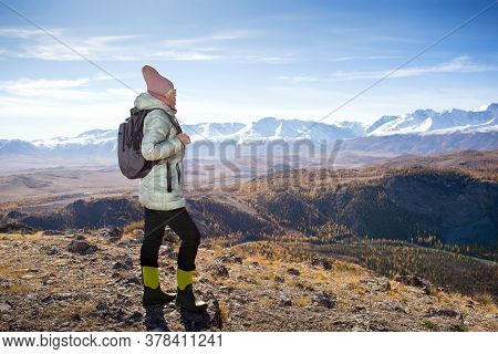 Woman Hiking In Autumn Mountain. Hiker Walking On A Mountain At Autumn Day. Copy Space.