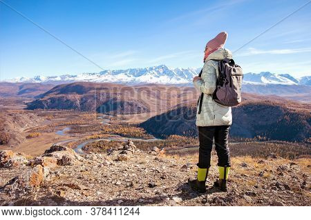 Hiking Woman With Backpack Looking At Inspirational Autumn Mountains.