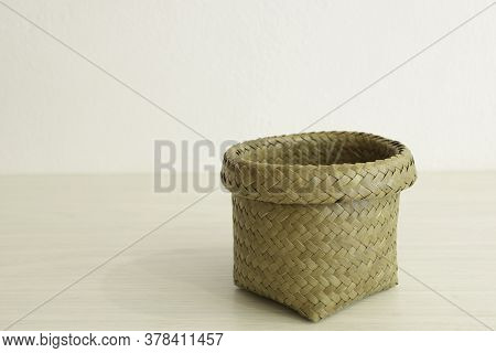 Basket For Use To Put Small Things On The Desk. Wickerwork From Natural Materials Is An Environmenta