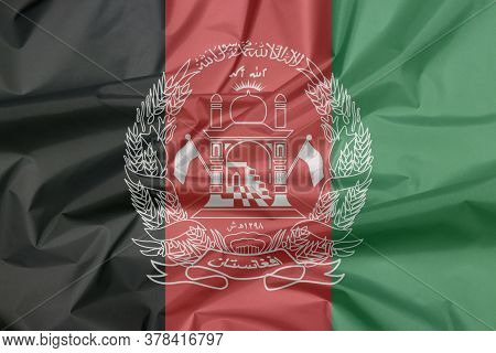 Fabric Flag Of Afghanistan. Crease Of Afghanistan Flag Background, Black Red And Green With The Nati