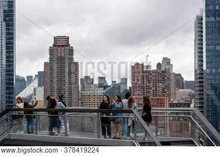 New York, Usa - June 21, 2019: Tourists From Wessel Looking At Manhattan Landscape With Residential