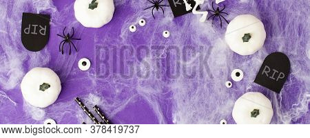 Happy Halloween Holiday Concept. Scary Decorations, Spider Web, Pumpkins, Headstone Tomb Rip On Purp