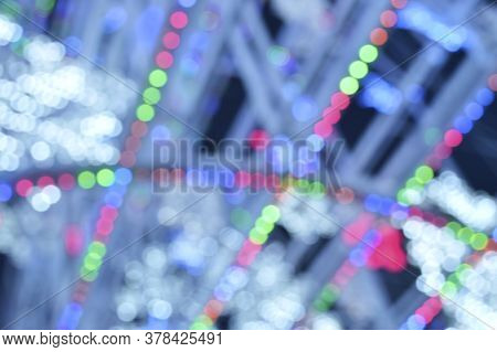 Abstract Blur Of Colorful Beautiful Bokeh Glitter Light, Christmas And New Year Festive Background