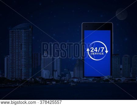 24 Hours Service Flat Icon On Modern Smart Mobile Phone Screen Over Office City Tower, River And Fan