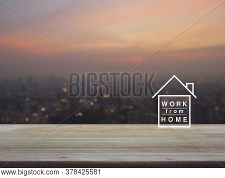 Work From Home Flat Icon On Wooden Table Over Blur Of Cityscape On Warm Light Sundown, Business Soci