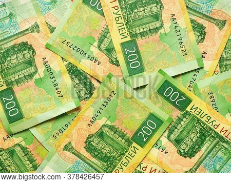 A Field Of Russian Banknotes 200 Rubles. View From Above. The Banknote Depicts The Sights Of Tauric