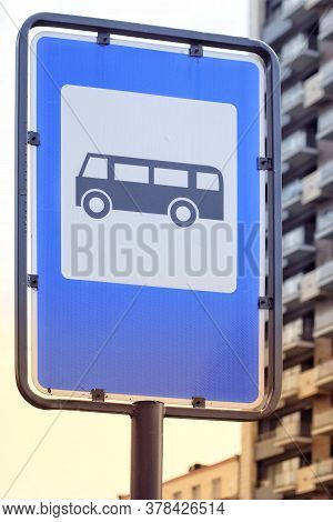 Bus Stop Sign In The Street In Blue Ad White Colors.