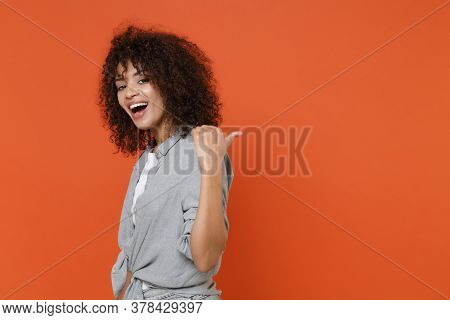 Side View Of Funny Young African American Woman Girl In Gray Casual Clothes Isolated On Orange Backg