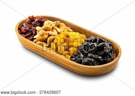 Various Dried Fruit In A Wooden Tray On White Background With Clipping Path.