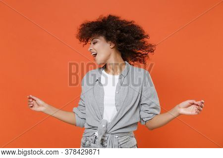 Cheerful Young African American Woman Girl In Gray Casual Clothes Isolated On Orange Wall Background
