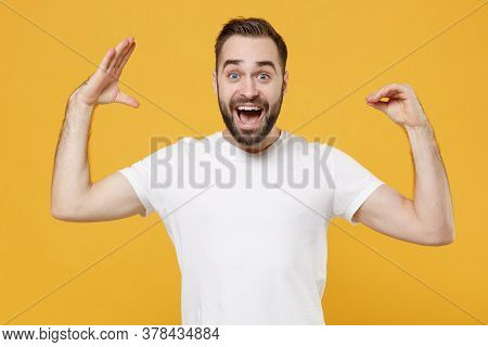 Excited Young Bearded Man Guy 20s In White Casual T-shirt Posing Isolated On Yellow Background Studi