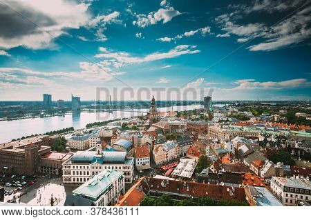 Riga, Latvia. Riga Cityscape Slyline In Sunny Summer Day. Famous Landmarks - Riga Dome Cathedral And