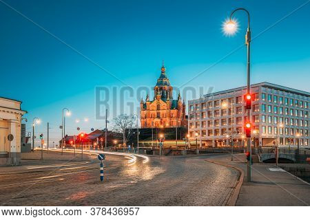 Helsinki, Finland. View Of Uspenski Cathedral In Evening Night Illuminations.