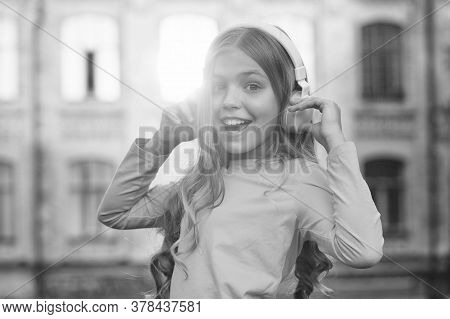 Music Makes My Day. Happy Kid Listen To Music Outdoors. Fun And Entertainment. Little Child Wear Hea