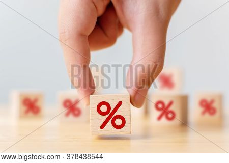 Interest Rate Financial And Mortgage Rates Concept. Hand Choosen Wooden Cube Block With Icon Percent
