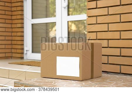 Delivered Parcel On Porch Near Front Door