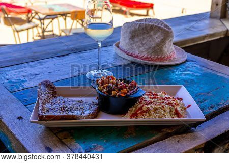 Hat On The Table With Food. Open Restaurant Sea View. Healthy Fresh Nutrition. Summer Beach Vacation