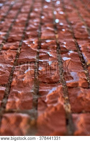 Loft Red Brick Wall, Angled View. Polished Brick Wall In Attic Interior. Background Texture For Desi