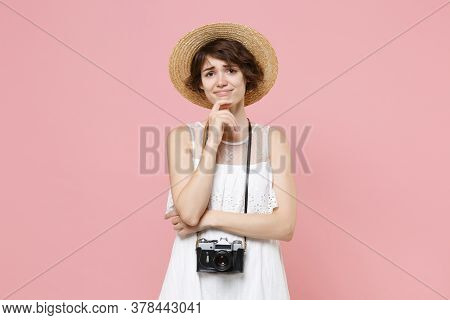 Confused Upset Young Tourist Woman In Summer White Dress Hat With Photo Camera Isolated On Pink Back