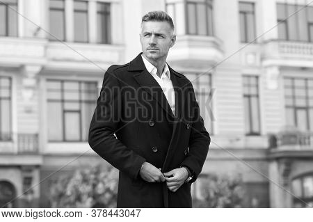 Man With Bristle On Unshaven Face. Street Style. Business Lifestyle. Mature Businessman In Black Coa