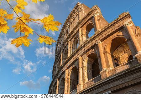 Famous Italian Landmark Colosseum In Rome In Autumn.