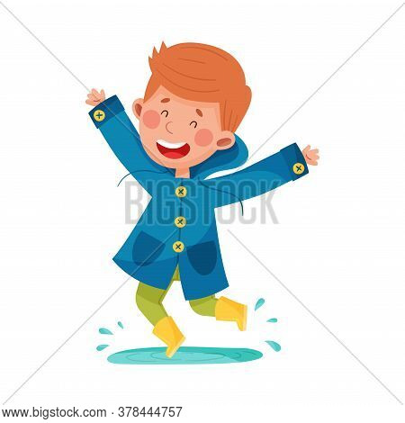 Joyful Boy Character In Rubber Boots And Raincoat Jumping In Puddle Vector Illustration