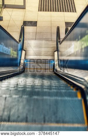 empty stairway rolling continuously, shopping complex