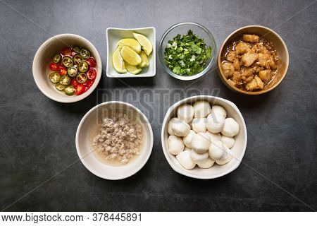 Fish Ball, Garlic Cracklings With Lard, Mined Pork, Pickled Chili, Lime And Coriander With Spring On