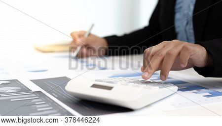 Marketing businessmen are analyzing financial and insights strategies for generating revenue includi