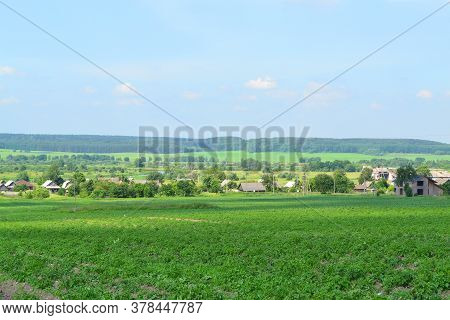 Beautiful Summer Landscape In A Village In Belarus. A Beautiful Summer Day In The Countryside. Villa