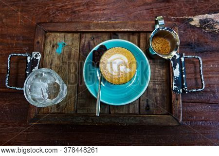 Top View Of Hot Coffee Latte With Latte Art, On Wooden