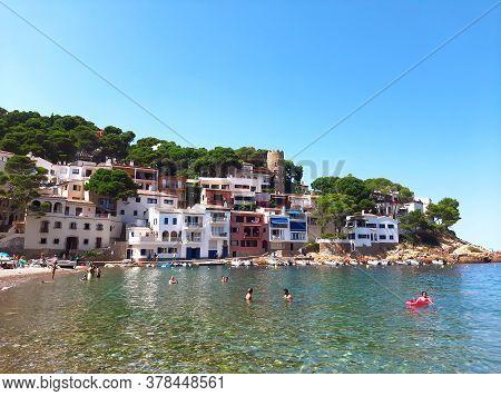 26.07.2020: Sa Tuna, Begur, Costa Brava, Spain. Colorful Houses In Sea Bay With Beach In Coastal Med