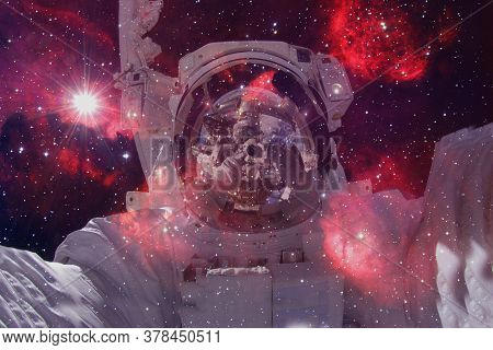 Astronaut. Nebula, Cluster Of Stars. Elements Of This Image Furnished By Nasa