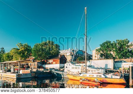 Riga, Latvia - July 1, 2016: Riga, Latvia. Old Yacht Moored At The City Pier Harbour Bay And Quay In