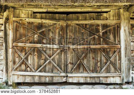 Wooden Barn Door. Rustic Vintage Desk Construction Background. Countryside Grunge Architecture Textu