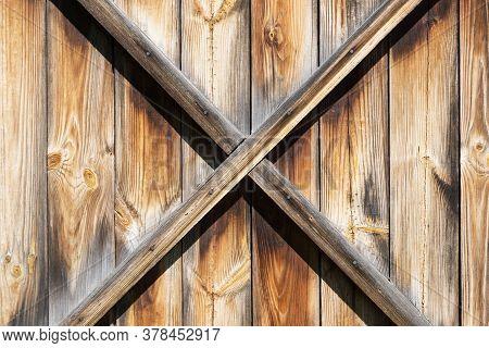 Grunge Wooden Barn Door. X Shape Wooden Desks. Rustic Vintage Desk Construction Background. Countrys