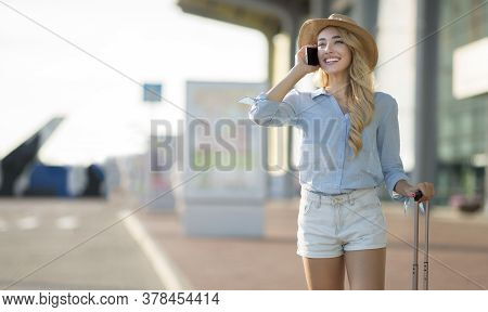 I Arrived. Young Woman Traveller Wearing Sun Hat, Talking On Mobile Phone After Flight Arrival In Ai