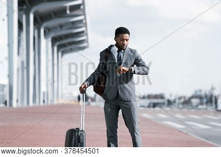 African American Businessman With Travel Suitcase Looking At Watch Checking Time Waiting For Delayed