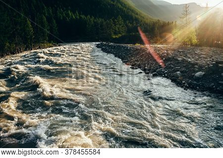 Beautiful View To Powerful Mountain River In Golden Light. Scenic Landscape With Mountain River Alon