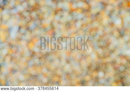 Vivid Blurry Background With Many Small Bokeh Of Different Colors And Shades. Multicolor Blur Textur