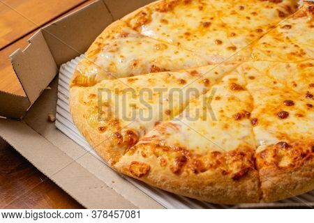 Pizza Extra Cheese Is Menu In The Restaurant.
