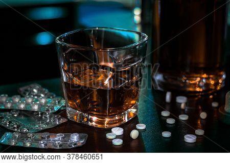 Alcohol And Pills Addiction Concept Close Up