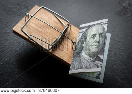 Mousetrap With A Dollar Bill On A Black Background Concept For Free