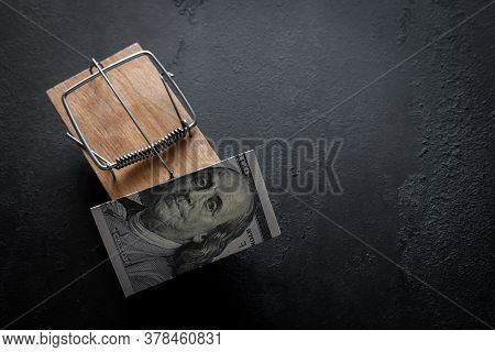Wooden Mousetrap With Money Bait On A Black Background With Place For Text